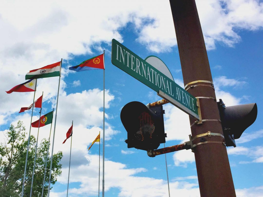 A. International Avenue Street Sign and Flags