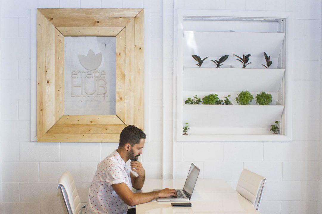 A. emergeHUB yyc Working at Laptop