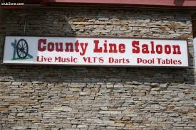 A. County Line Saloon Sign